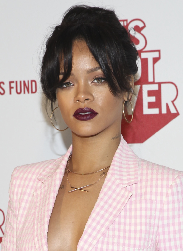"""LOS ANGELES, CA - NOVEMBER 18:  MAC Viva Glam Spokesperson Rihanna attends MAC Cosmetics And MAC AIDS Fund World Premiere Of """"It's Not Over"""" Film Directed By Andrew Jenks on November 18, 2014 in Los Angeles, California.  (Photo by Jonathan Leibson/Getty Images for MAC Cosmetics)"""