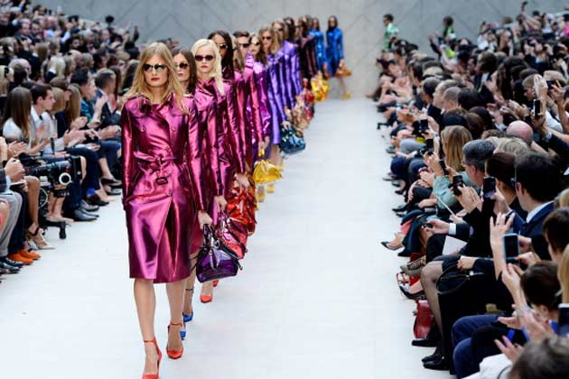 model showcases designs on the catwalk by Burberry Prorsum on day 4 of London Fashion Week Spring/Summer 2013